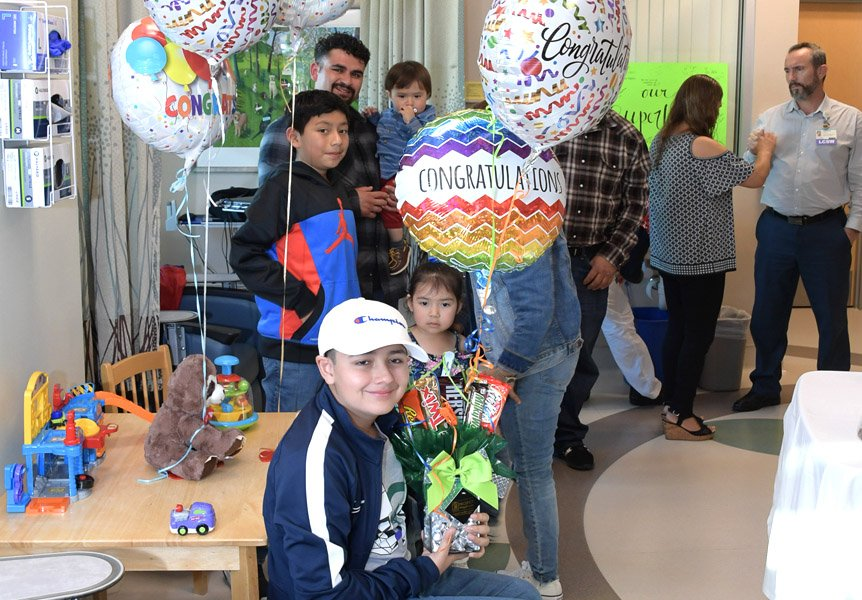 Patient and family celebrating last day of Chemotherapy