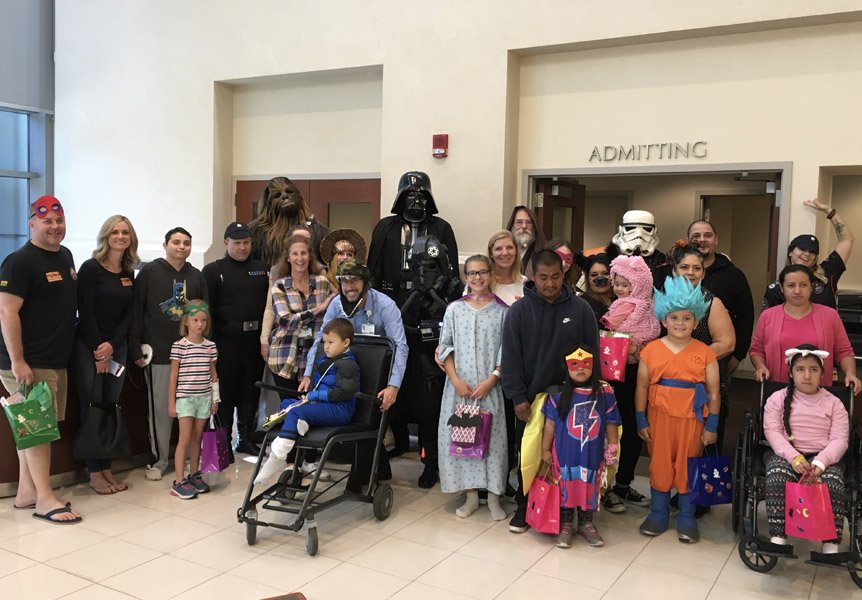 Patients, families and staff celebrating Halloween