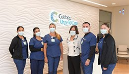 Urgent Care location staff standing in the lobby with masks on