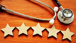 A stethoscope and 5 wooden stars